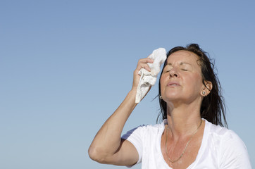 Mature woman menopause stress sweating