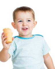 happy child boy eating ice cream in studio isolated