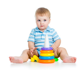 baby boy playing with colorful toy isolated on white