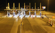 Highway toll collection point at night in Spain