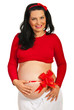 Pregnant woman with red ribbon