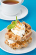 homemade waffles with whipped cream and poppy closeup