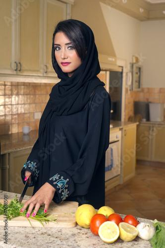 Arabian Lady Wearing Hijab Cutting Veggies for Salad