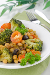 warm salad with chickpeas, broccoli, raisins, closeup
