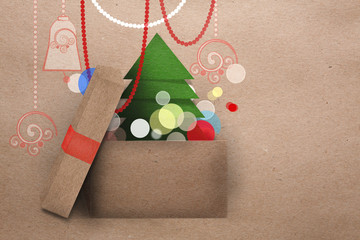 Open cardboard box with Christmas tree