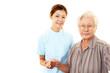 手を取り微笑む看護師と高齢者