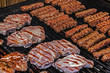 Romanian sausages and red meat on a grill-1