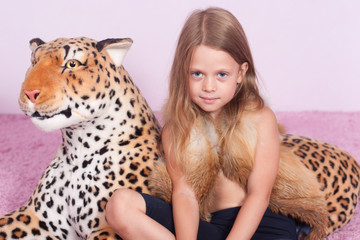 Little girl and toy leopard