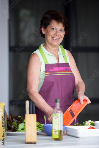 Older woman making a salad