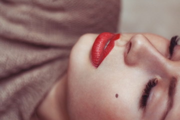Glamorous portrait of a beautiful young woman with red lips