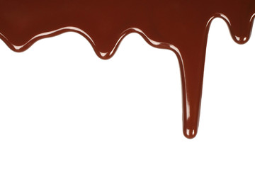 Melted chocolate dripping on white background .