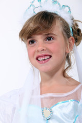 little girl dressed as bride
