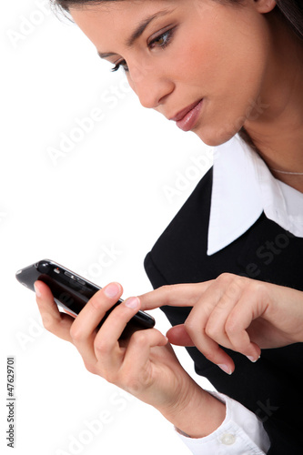 Woman typing on her mobile