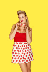 Retro fashion model in red polka dots