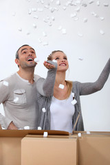 couple making polystyrene chips fly