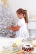 Cute girl decorating Christmas tree
