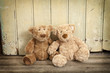 two teddybears on wood