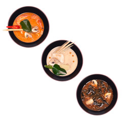 Set of traditional chinese soup in a black plate