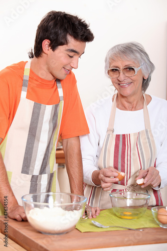 grandmother and grandson cooking together