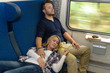 Couple sleeping in train woman man vacation