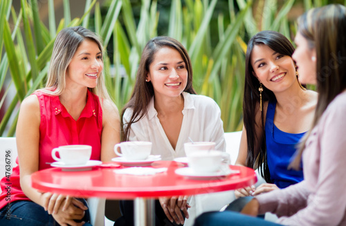 Women talking over coffee