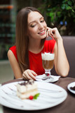 Attractive young woman has a rest in restaurant