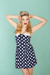 Retro model in polka dot dress