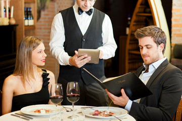 Couple having dinner in a luxury restaurant