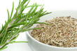 Fresh rosemary and a bowl with dried