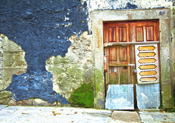 Old wooden door in Portugal. Porto.