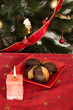 Christmas sweets and candle on the table