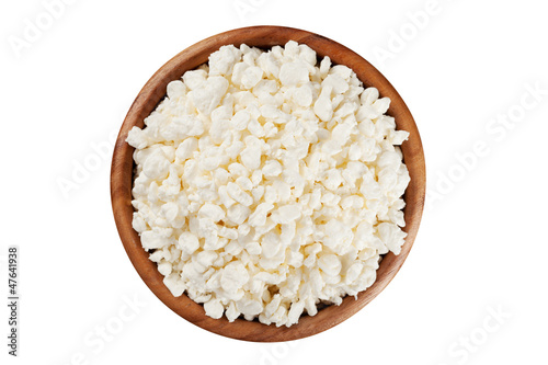 cottage cheese in the rustic wooden plate