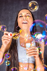 the Latin American female with soap bubbles