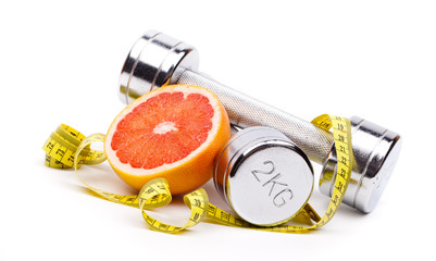 fitness dumbells  and fruits