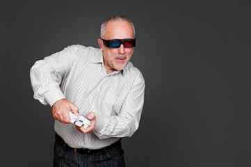 senior man in 3d glasses playing in video game