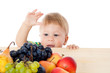 Baby with pile of fruit