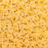 Fototapety Italian Farfalle Pasta raw food background or texture