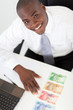 happy young african businessman with bank notes