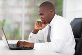 Fototapety thoughtful young african american businessman