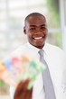 happy young african businessman with cash notes