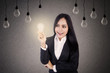 Businesswoman with light bulbs