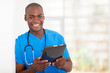 african american health care worker with tablet computer