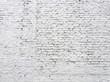 Cracked white brick wall