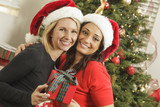 Young Mixed Race Girlfriends with Christmas Gift