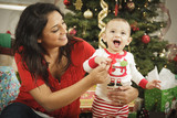 Ethnic Woman With Her Newborn Baby Christmas Portrait