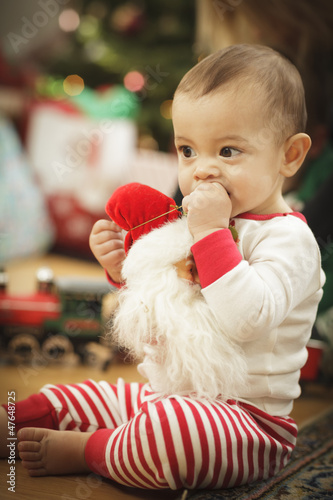 Infant Baby Enjoying Christmas Morning Near The Tree