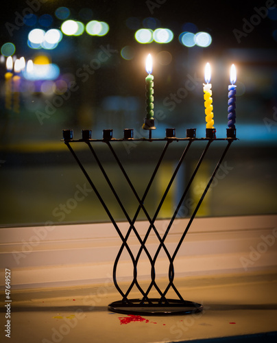 Candles and hanukkah menorah with defocus background