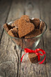 Chocolate Cookies in the Shape of Heart on Wooden Background