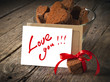 Valentine Card with Message Love You and Chocolate Cookies in th