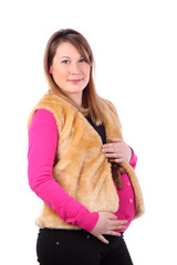 Beautiful young pregnant woman wearing in fur vest isolated
